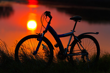 bike on the sunset background.