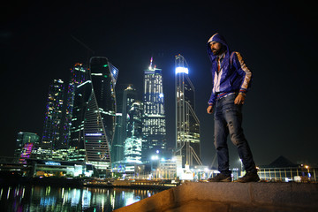 portrait of a man in a night cityscape skyscrapers lights