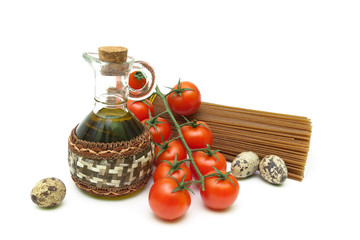 cherry tomatoes, pasta, quail eggs and olive oil on a white back