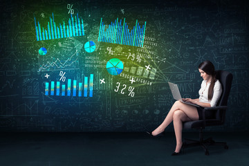Businesswoman in office with laptop in hand and high tech graph