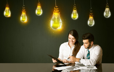 Business couple with idea bulbs