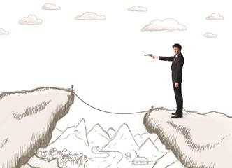 Businessman with drawn edge of mountain