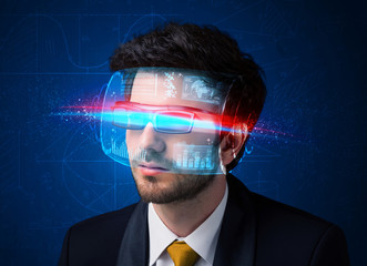 Man with future high tech smart glasses