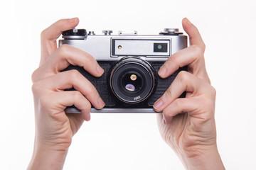 Pressing shutter in 35mm classic photo camera