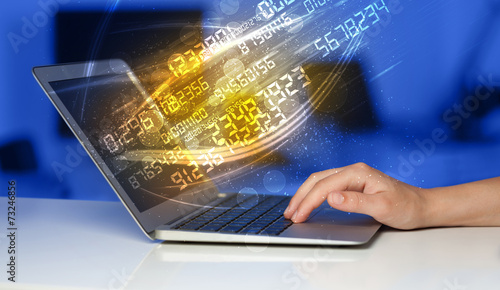 canvas print picture Man typing on modern notebook with number technology data coming
