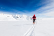 Mountaineer walking on a glacier during a high-altitude winter e