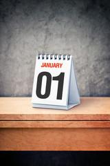 January the 01st on desk calendar at office table