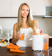 Girl making carrot juice