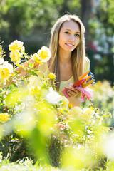 Female florist working in garden