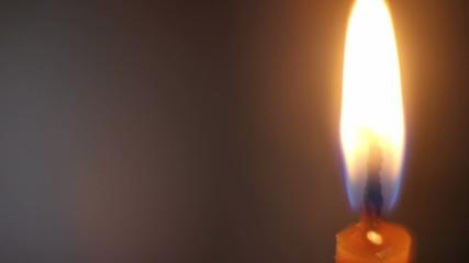 Orange burning candle close-up