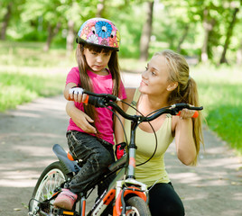 beautiful mother calms the sad daughter who did not get to ride