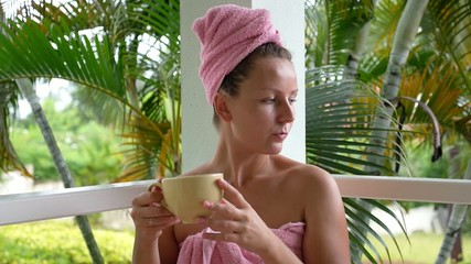 Natural Woman Wrapped in Pink Towel Drinking Coffee in Morning.
