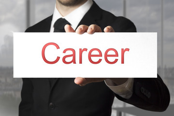 businessman showing white sign career