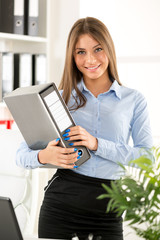 Young Businesswoman With Binder