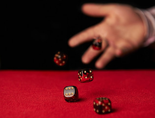Male hand rolling dice