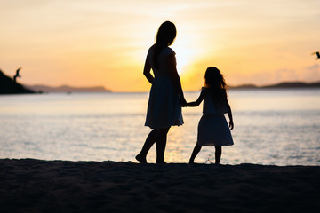 Mother and daughter at sunset