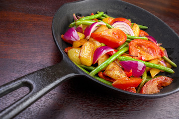 Frying pan with cooked vegetables