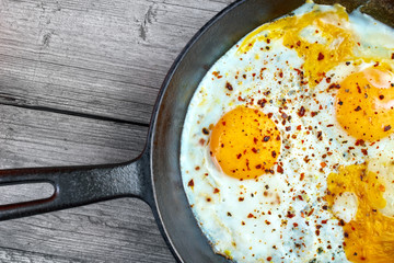 Fried eggs in cast iron frying pan  , upper view
