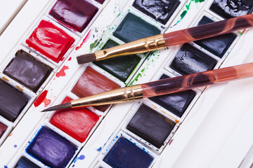 artists watercolour paints and paint brush