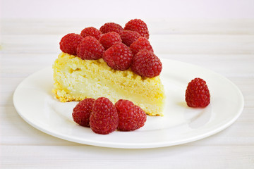 cake with raspberries on a white plate