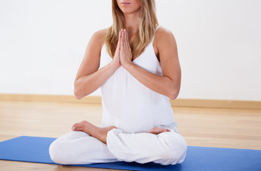 Woman training yoga at the gym