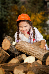 Children helping stack firewood