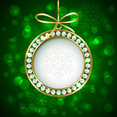 Christmas ball with diamonds on green background