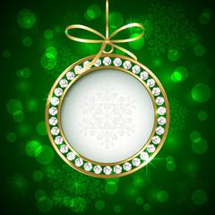 Christmas ball with diamonds on green background