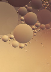Bubbles floating on water with texture against a colored backgro