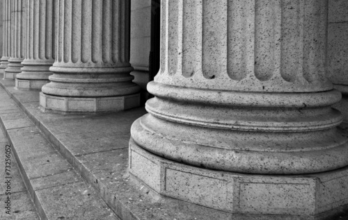 Fotobehang Bedehuis Architectural Columns on the Portico of a Federal Building in Ne