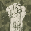 Fist symbol (revolution) on military camouflage background. Vect