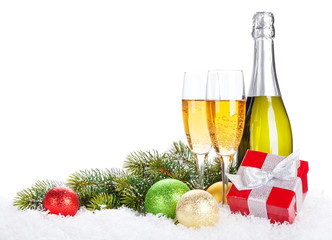 Champagne, christmas decor and gift box
