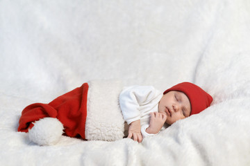 baby sleeping in Santa hats