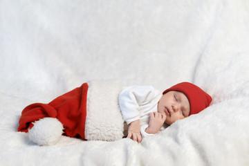 baby sleeping in Santa hats