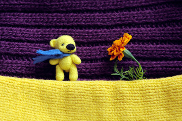 Toy yellow bear and flower