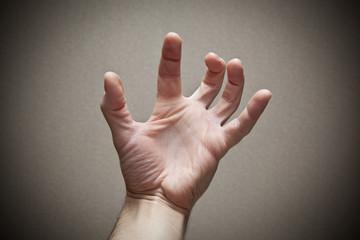 Hand in frightening gesture