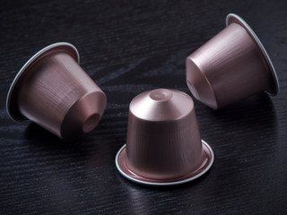 Pink Coffee capsules on black background