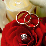 Gold wedding rings on a bouquet of flowers for the bride