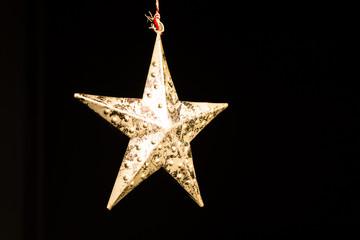 gold star against black background
