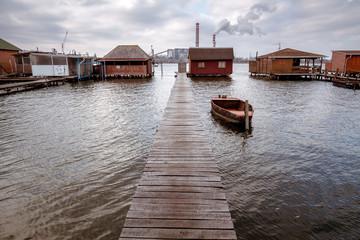 Bokod lake with pier, boat and fishing huts