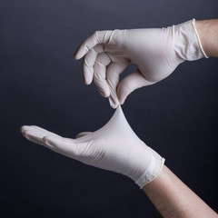 Male hands in latex gloves