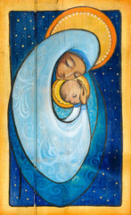 Madonna and infant Jesus painted on a wood.