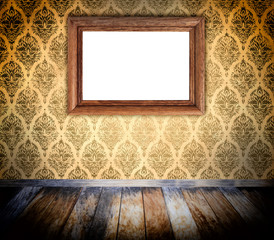 Old wooden frame on grunge wall.