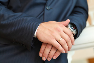 Hand of the groom  with wedding rings at a wedding party