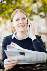 Businesswoman Discussing the News