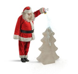 Santa watering a Christmas tree