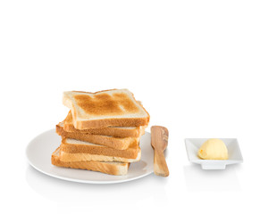 Stack of toasts with butter on white background.