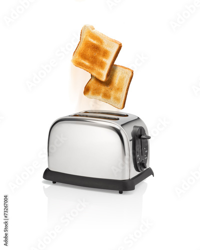 Roasted bread pops out from toaster. - 73267004