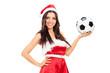 Female Santa Claus holding a football