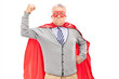 Senior in superhero outfit with his fist in the air